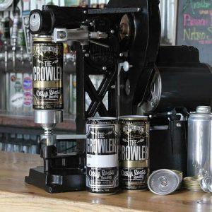 Beer crowlers being canned.