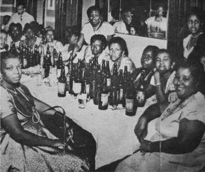 Black Brazilian women drinking beer.