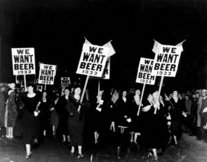 """Women turn out in large numbers, some carrying placards reading """"We want beer,"""" for the anti prohibition parade and demonstration in Newark, N.J., Oct. 28, 1932. More than 20,000 people took part in the mass demand for the repeal of the 18th Amendment."""