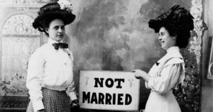 """Two women with a sign that says """"Not Married"""""""