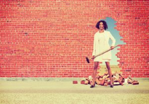 Woman knocking down bricks.