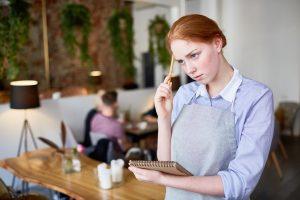 Young waitress upset